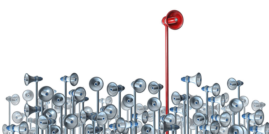 Image of one megaphone standing out from the rest